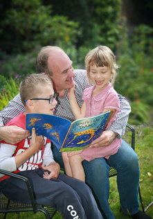 Ed Davey reading to children